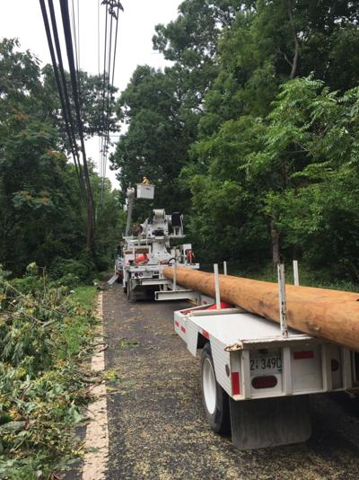 Crews working to open Long Hill roads; trees and wires down in 20 different locations
