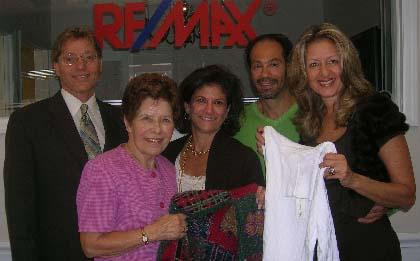 RE/Max realty collects sweaters