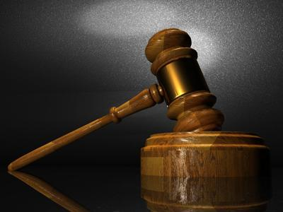 Woman files suit against bank, former employee, for theft from husband's estate
