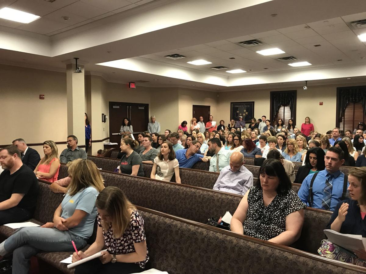 Following outcry, Long Hill school board tables vote to cut aides to part-time