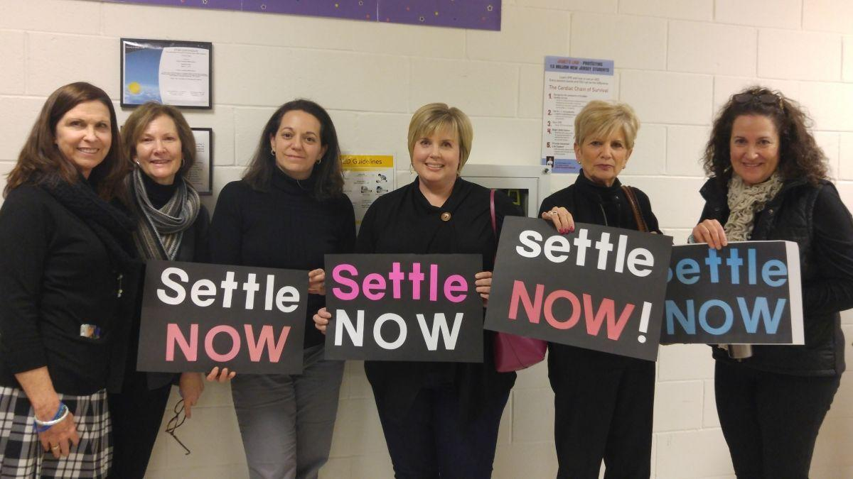 Teachers don black garb to fight for long-delayed contract renewal