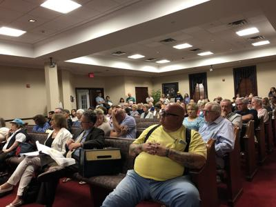 Nearly 100 residents attend Planning Board meeting