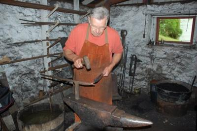 Red Mill Museum Village hosts annual Blacksmith Hammer-In on Saturday. Aug 24