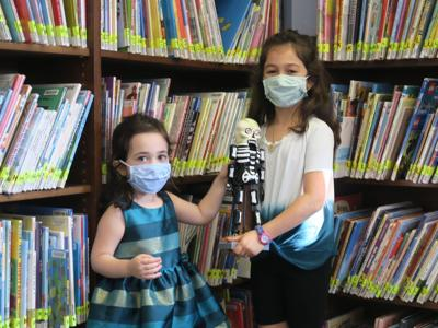 Watchung sisters discover Halloween decorations, picture books at the library