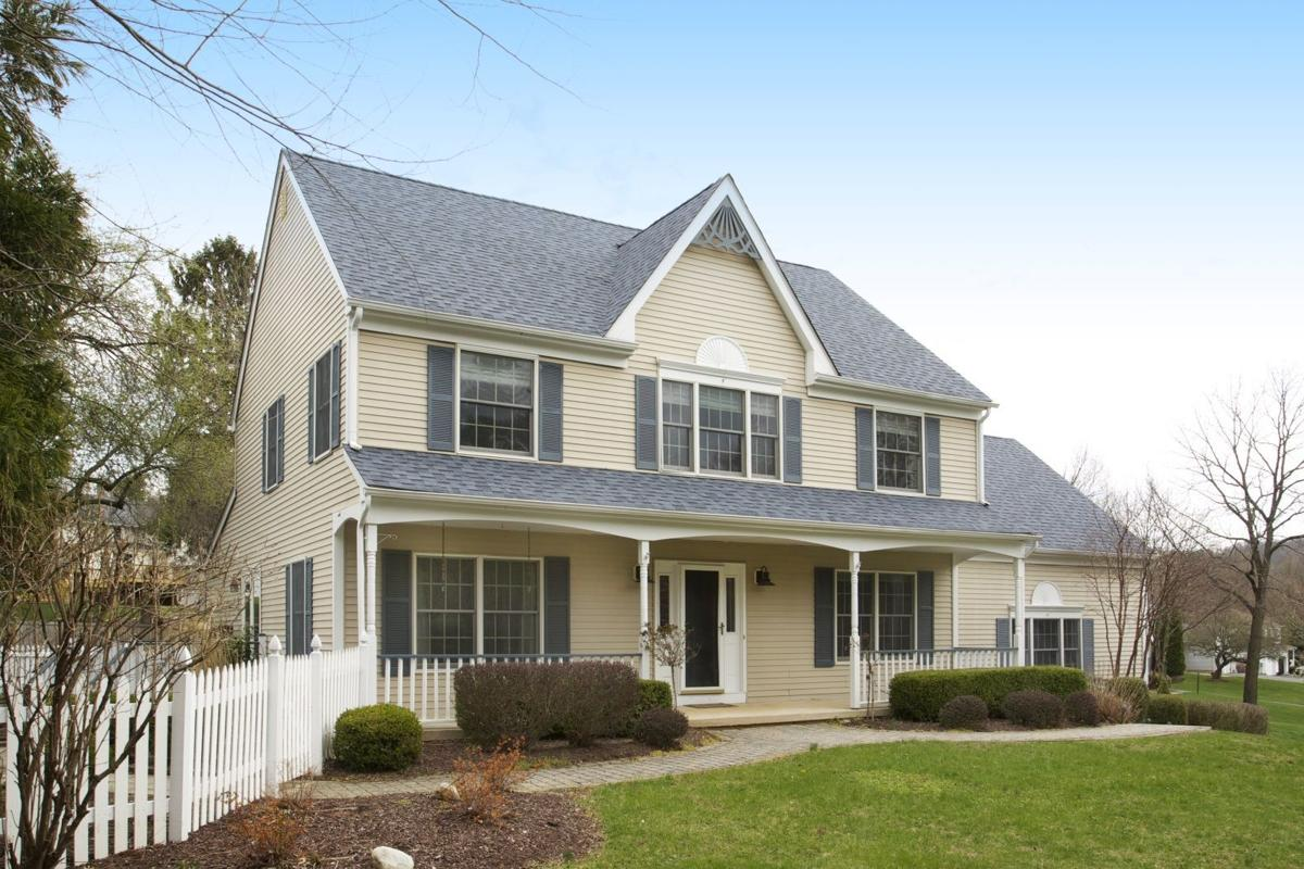 A Welcoming Farmhouse Colonial Complete With Wrap Around Front Porch And White Picket Fencing Is Surrounded By 086 Acre Of Park Like Grounds In