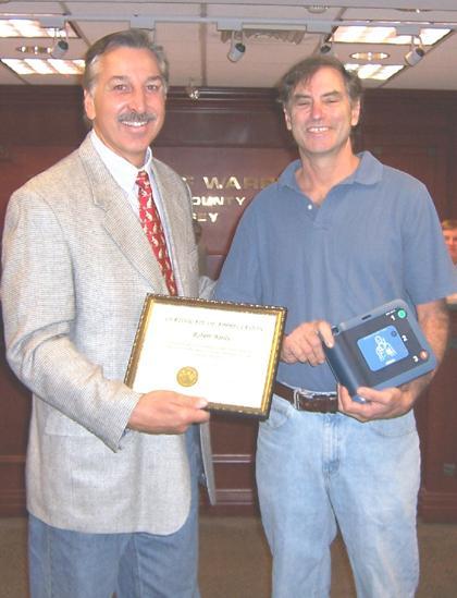 Warren businessman thanked for gift of defibrillators