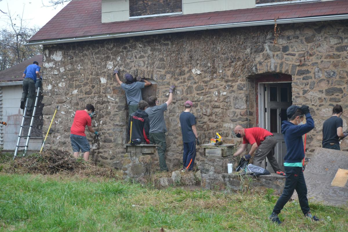 Boy Scouts clean up 1755 Gitlow farmhouse at Windy Acres