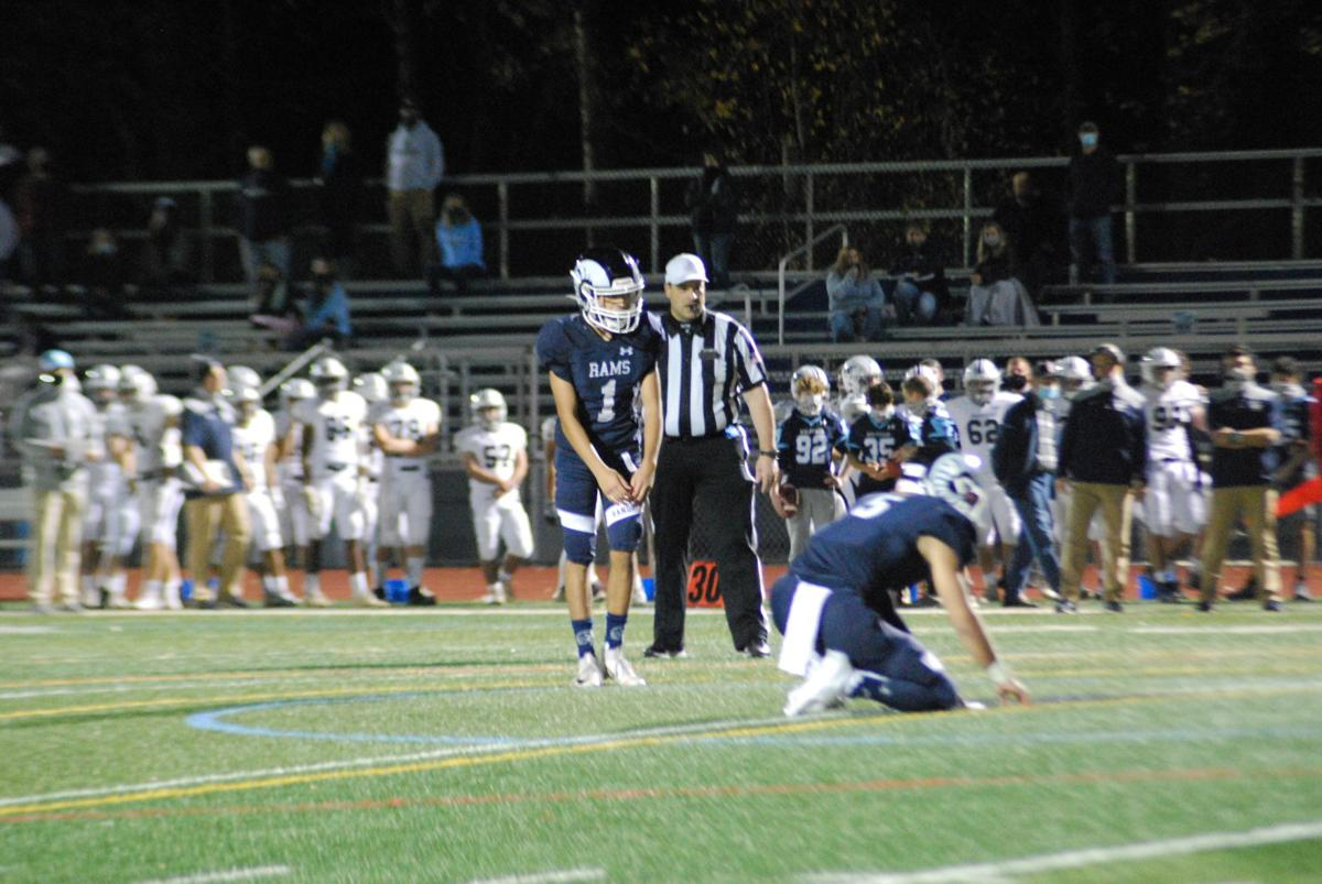 Amin winds up for an extra point attempt