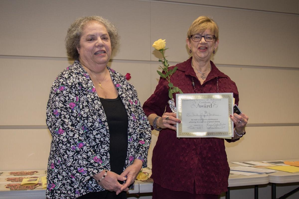 Sandra Duguid Gerstman accepts her award