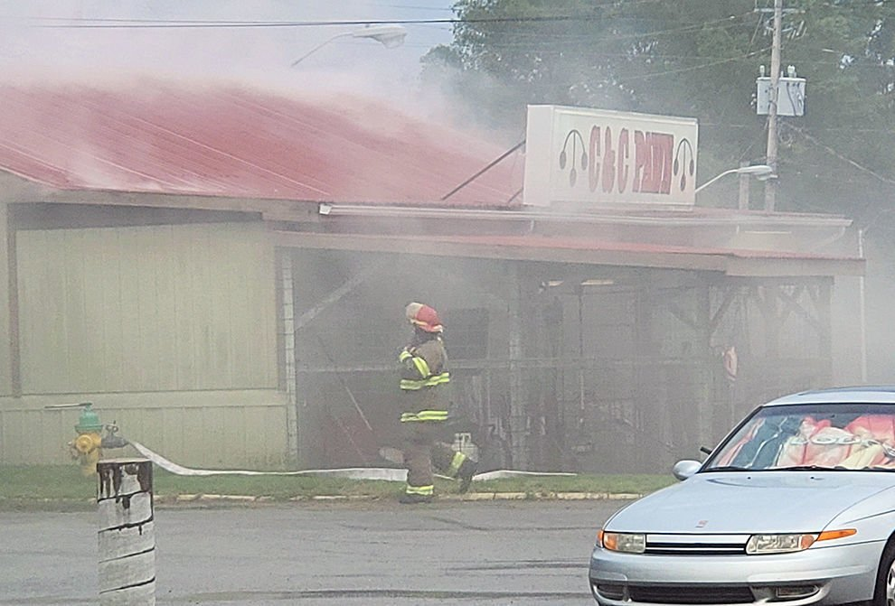 Smoke comes from roof of C&C Pawn