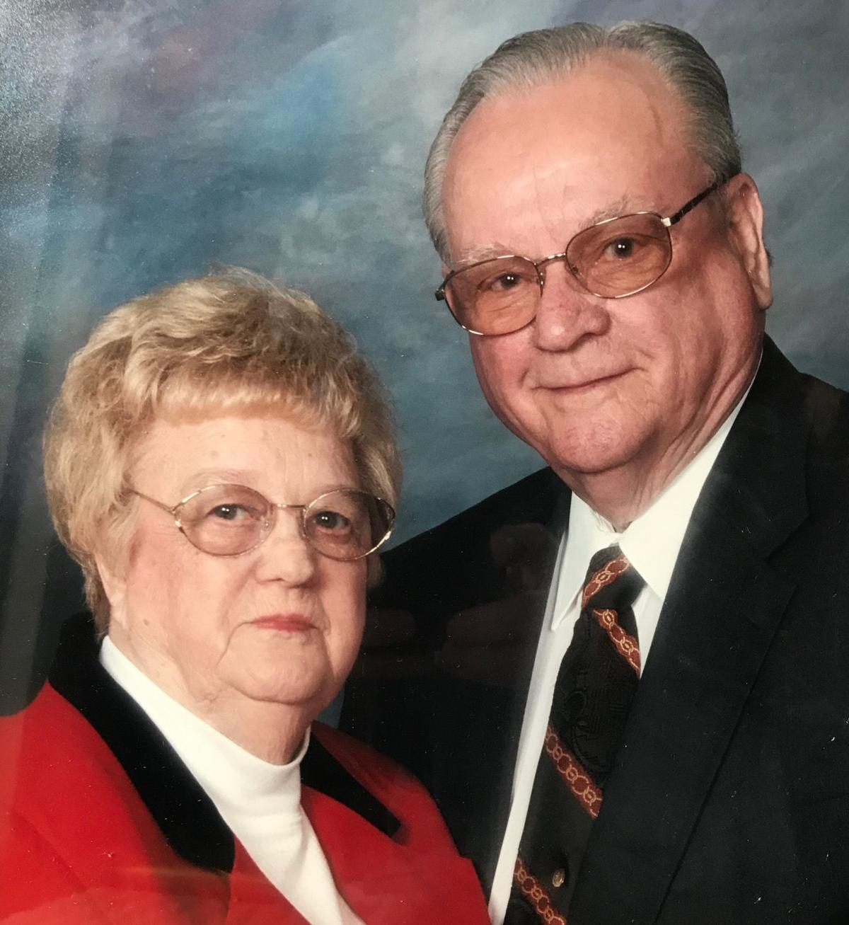 Sutton with wife