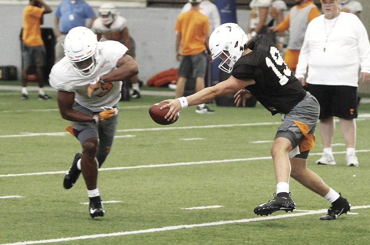 Eric Gray takes a handoff from quarterback Steven Orr in practice