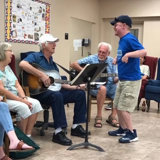 "Clients of the ALPS center enjoy a ""Pickin and Grinnin"" Session with Friends"