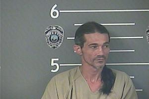 Police: Man threatened mother, officer during arrest