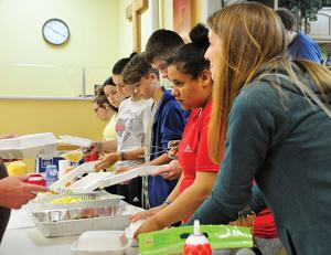 Mission trip students serve food in Pikeville