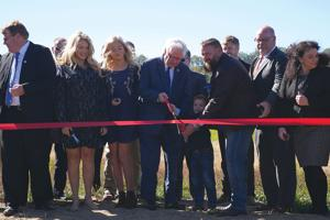 Officials cut ribbon for spec building with Silver Liner owner