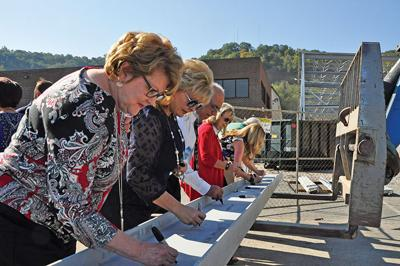 Steel signing marks progress for YMCA expansion