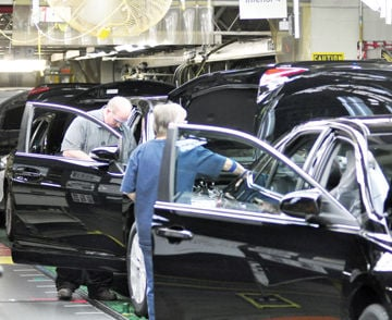 Toyota Motor Manufacturing, Kentucky Team Members Make Final Checks Over A  Pair Of Toyota Camry Sedans As They Roll Off The Assembly Line Recently.