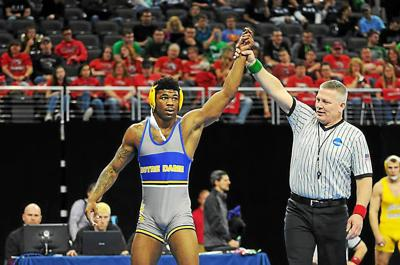 College wrestling: Notre Dame College's Joey Davis celebrating becoming an undefeated four-time NCAA champ