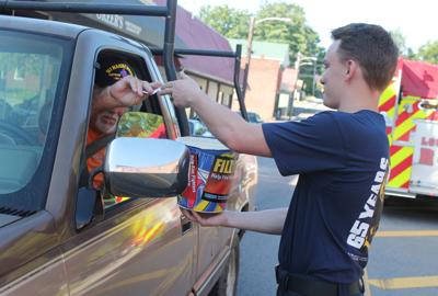 Firefighters work to Fill the Boot