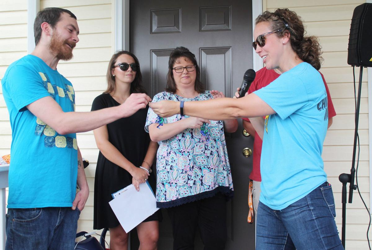 Habitat celebrates pair of dedications