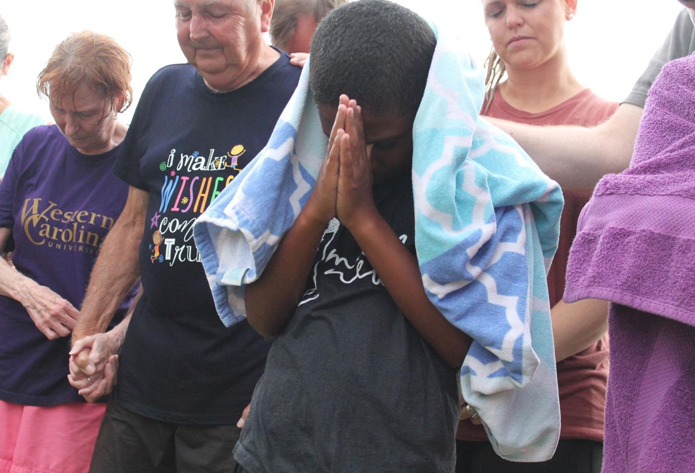 Baptisms show 'faith in action'