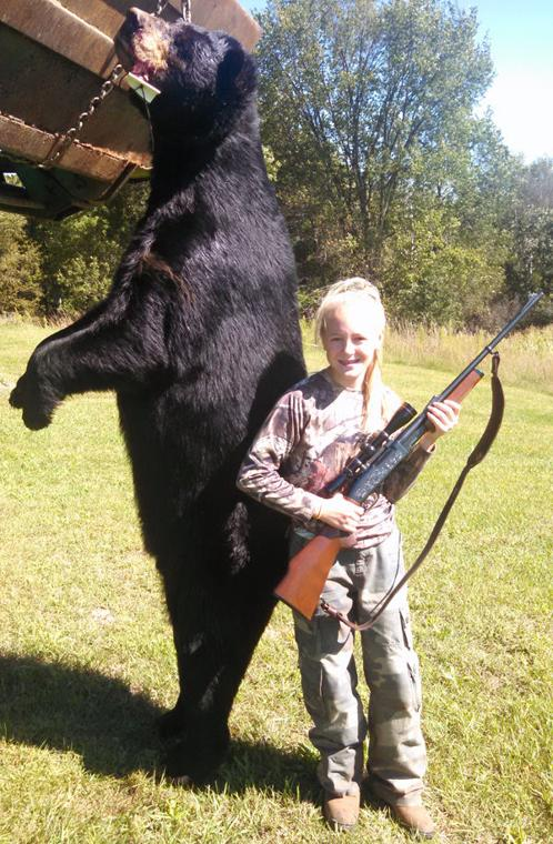 Youngster bags nearly 600-pound bruin!