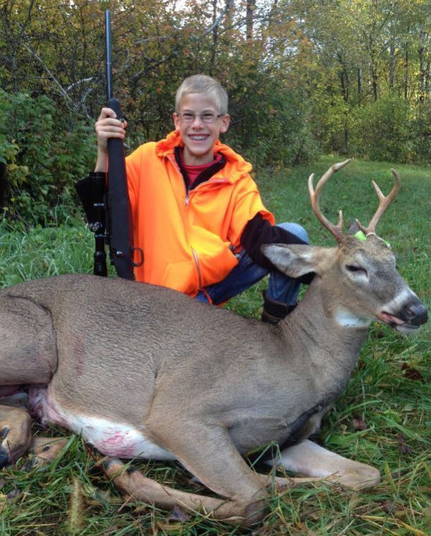 Youth hunt buck