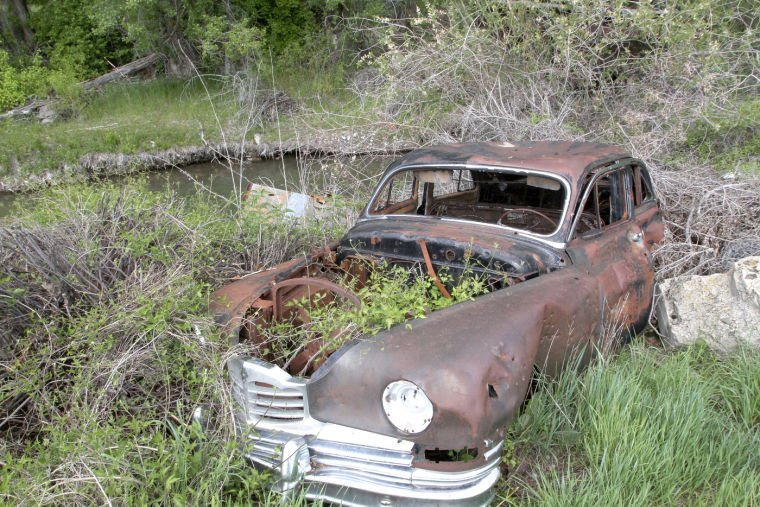 River Bank Revival: Old Cars Among Debris Unearthed In