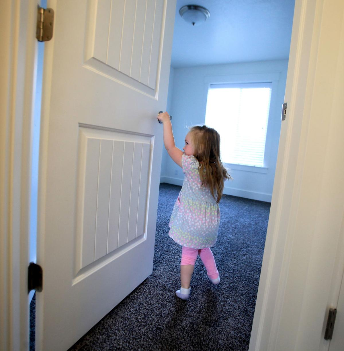 housing participants move into new hyrum homes business and