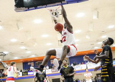 Spartanburg Day's Zion Williamson (12) makes a dunk while playing Keenan during the Chick-fil-A Classic at Richland Northeast High School on December 22, 2016.