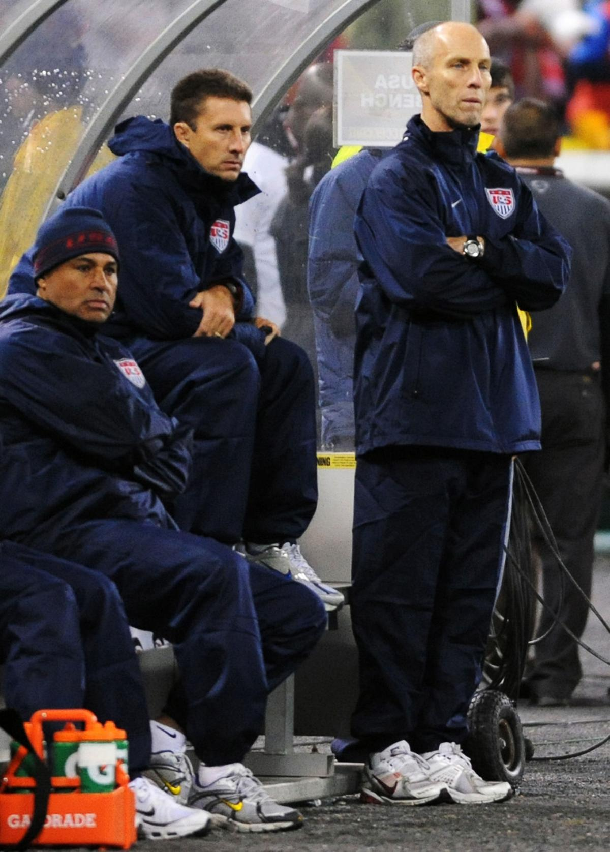 United States Men's National Team head coach Bob Bradley, right, watches his U.S. team play Costa Rica in a World Cup qualifying match at RFK Stadium in Washington, D.C., Wednesday, Oct. 14, 2009.