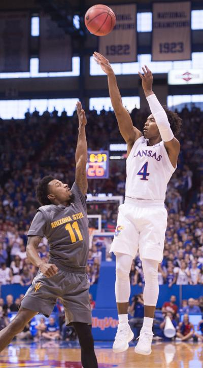 Arizona State Sun Devils guard Shannon Evans II (11) defends a three-pointer by Kansas Jayhawks guard Devonte' Graham (4) in the first half on Sunday, Dec. 10, 2017 at the University of Kansas in Allen Fieldhouse in Lawrence, Kan.