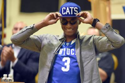 Immanuel Quickley wears a hat and jersey as he announces his commitment to play basketball at the University of Kentucky during a news conference at John Carroll School in Bel Air, Md., on September 22, 2017.