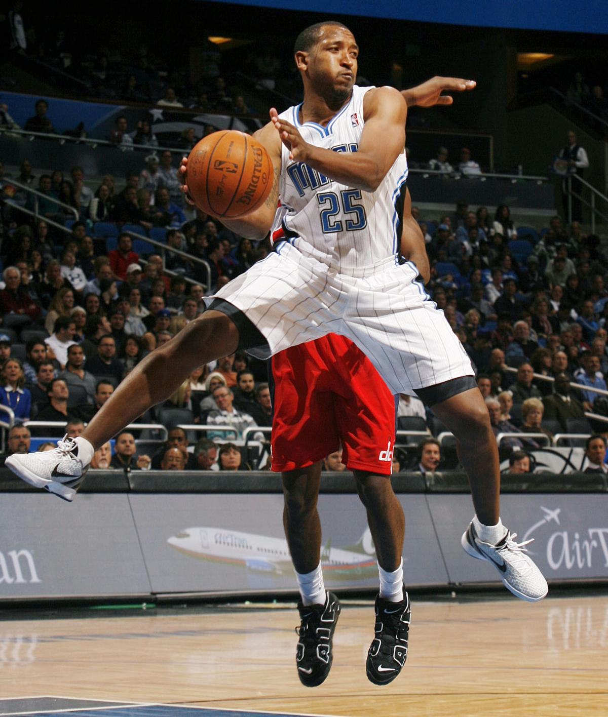 In a January 2012 file image, the Orlando Magic's Chris Duhon leaps to pass against the Washington Wizards at the Amway Center in Orlando, Fla. Duhon, who retired from the NBA in 2013, will be an assistant at Illinois State in the 2018-19 season.