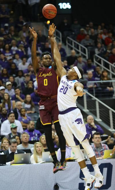 Loyola's Donte Ingram, left, shoots for three over Kansas State defender Xavier Sneed during the first half in an NCAA Tournament regional final at Philips Arena in Atlanta on Saturday, March 24, 2018.