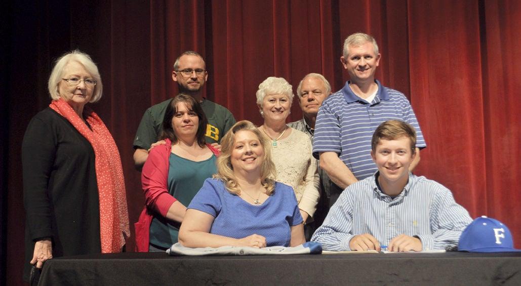 Jake Davis signs scholarship