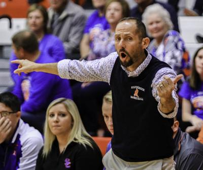 88bc837d6f8 Silver Creek head coach Scott Schoen motions for his team to hustle down  court during their game against Jeffersonville on Nov. 18, 2016.