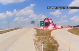 Video shows semi truck going airborne, bursting into flames
