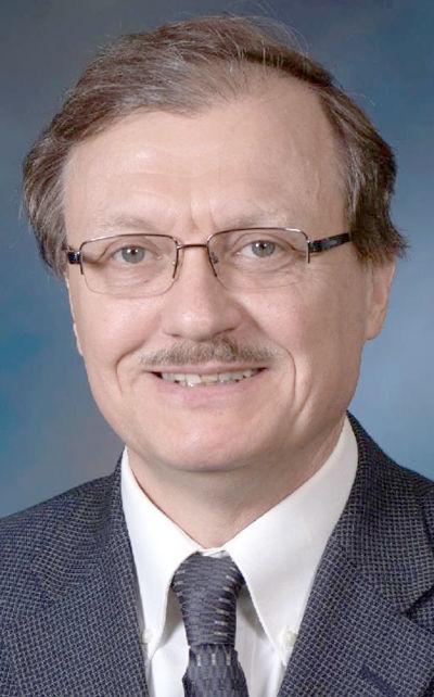 Dr. Andrew J. Krutul