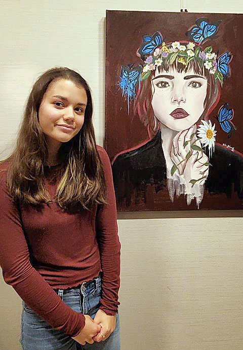 Akina poses with art