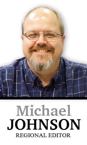 Michael Johnson column sig