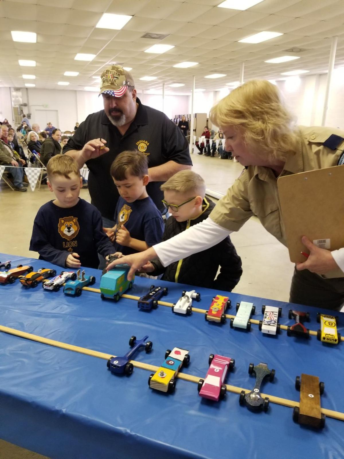 Showing Lion den scouts cars for best of show voting with Ty Auter, legion representative .jpg