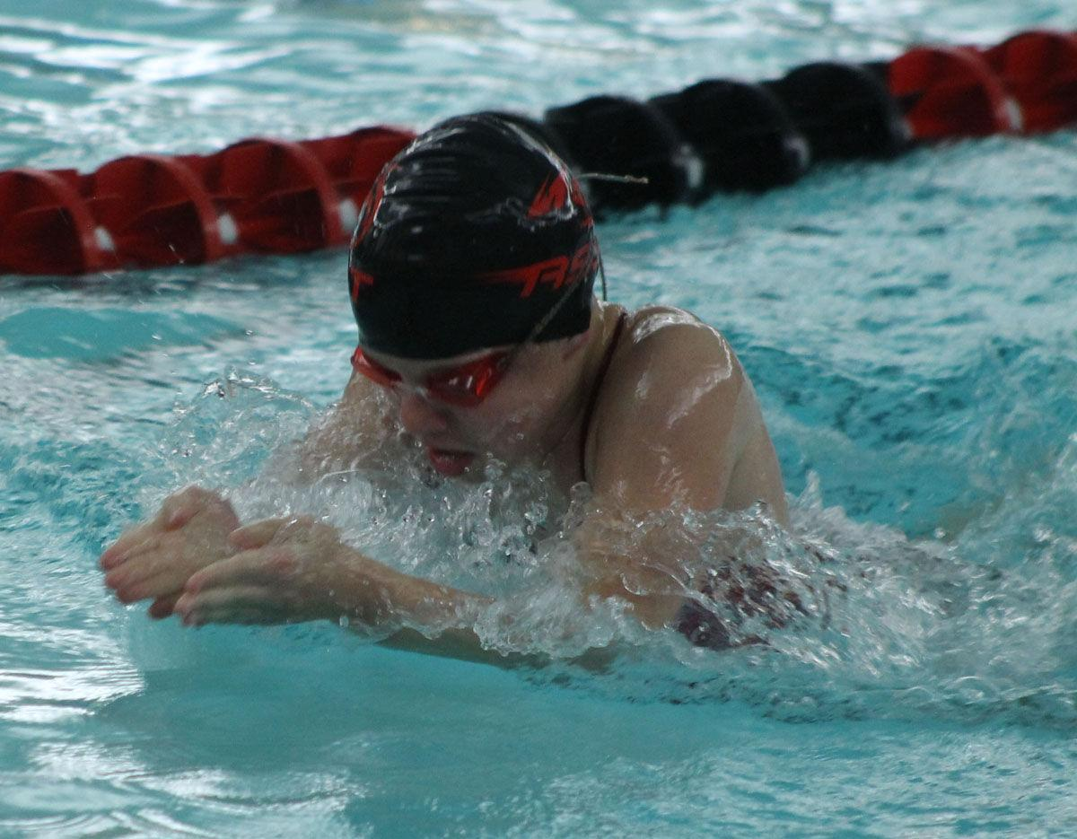 Nelson sets marks in breaststroke, 100 IM