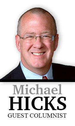 Dr. Michael J. Hicks column sig