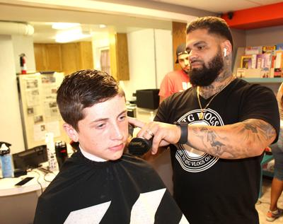 Barbers, hairdressers disappointed to not be returning to work