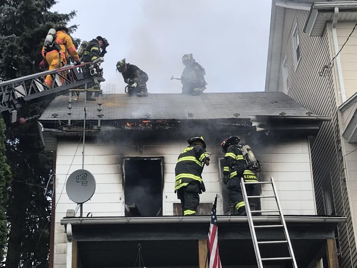 Firefighters venting roof