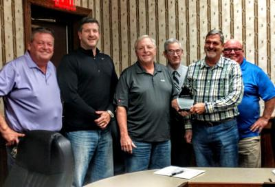 Welsh honored with plaque at final meeting