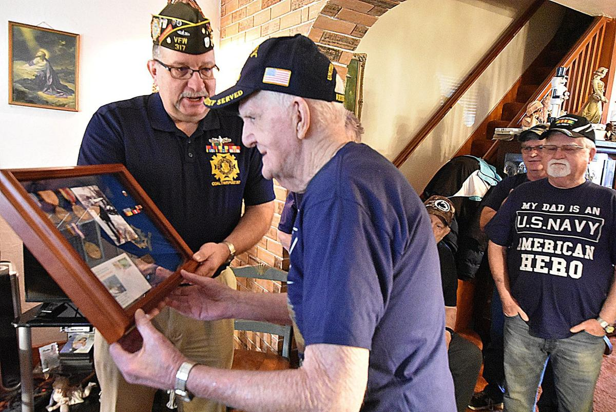 WWII Veteran receives service medals from VFW
