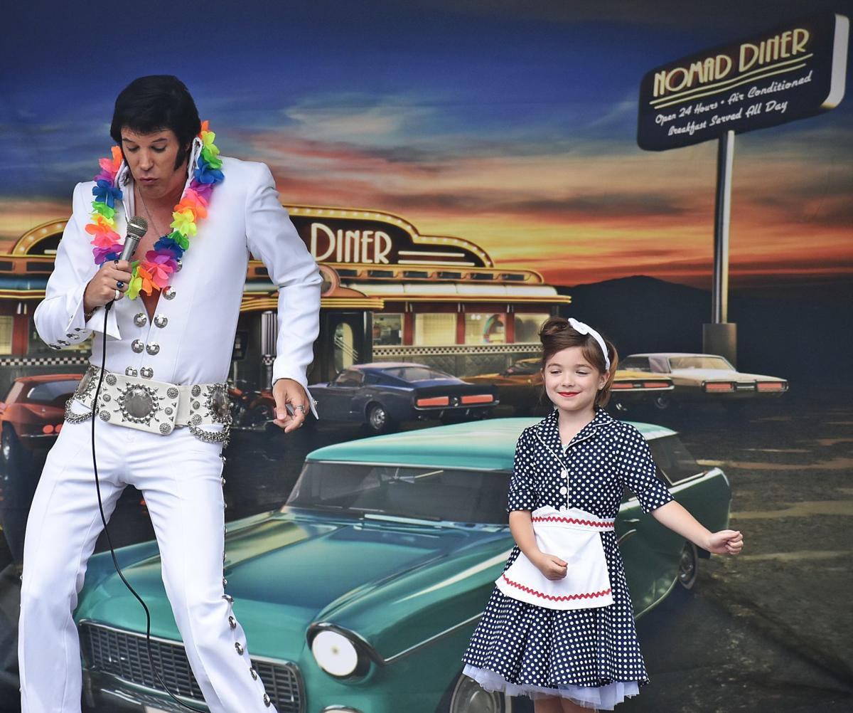 Doo Wop Elvis on stage with a young dancer